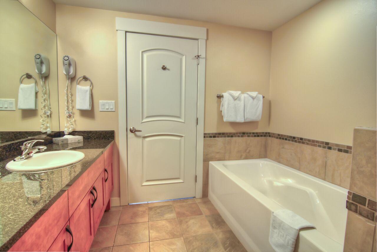 one bedroom silver kitchenette bathroom
